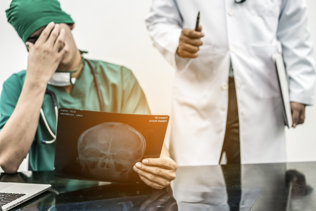 doctor and surgeon looking at xray