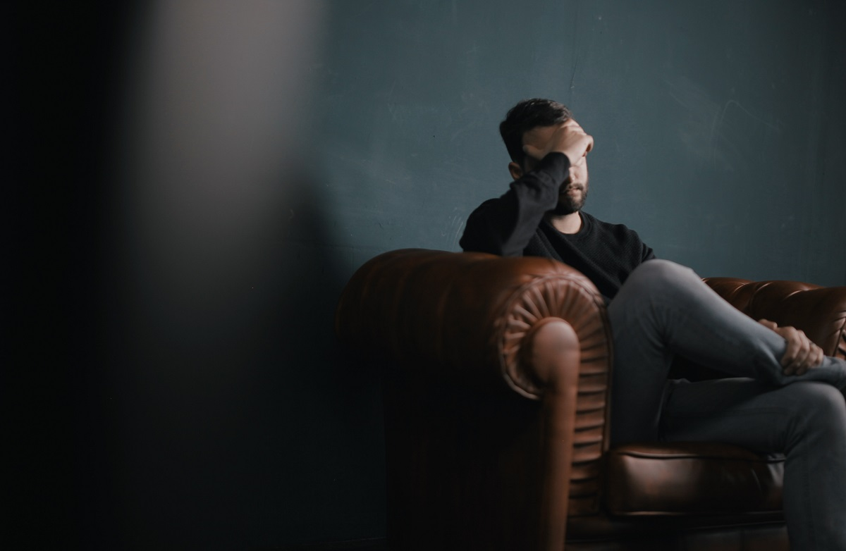 man feeling stressed out