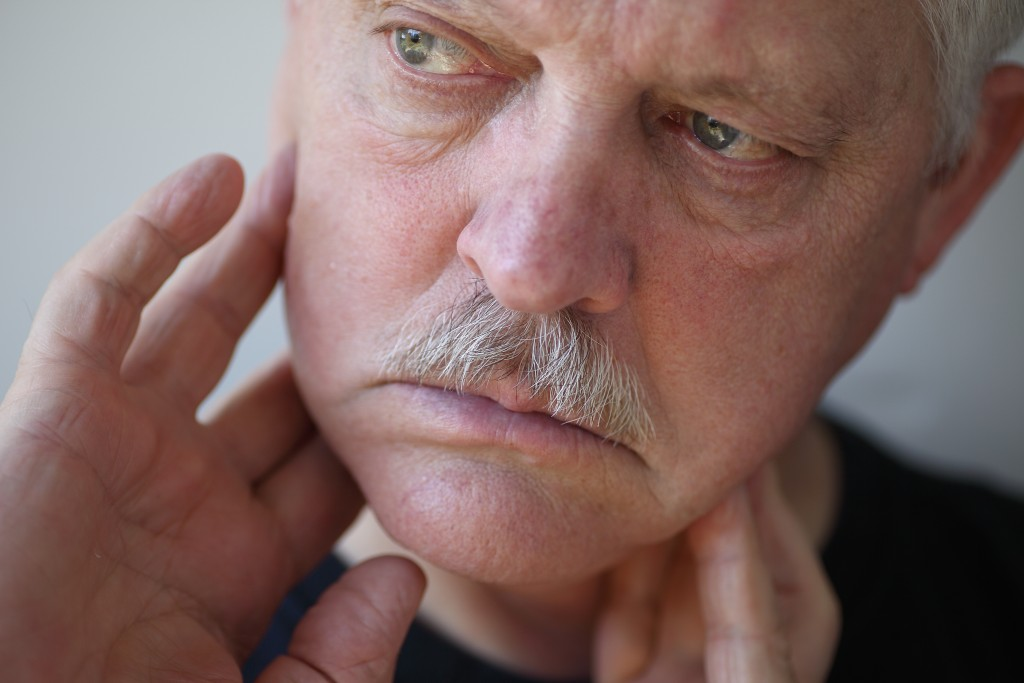 man with TMJ disorder