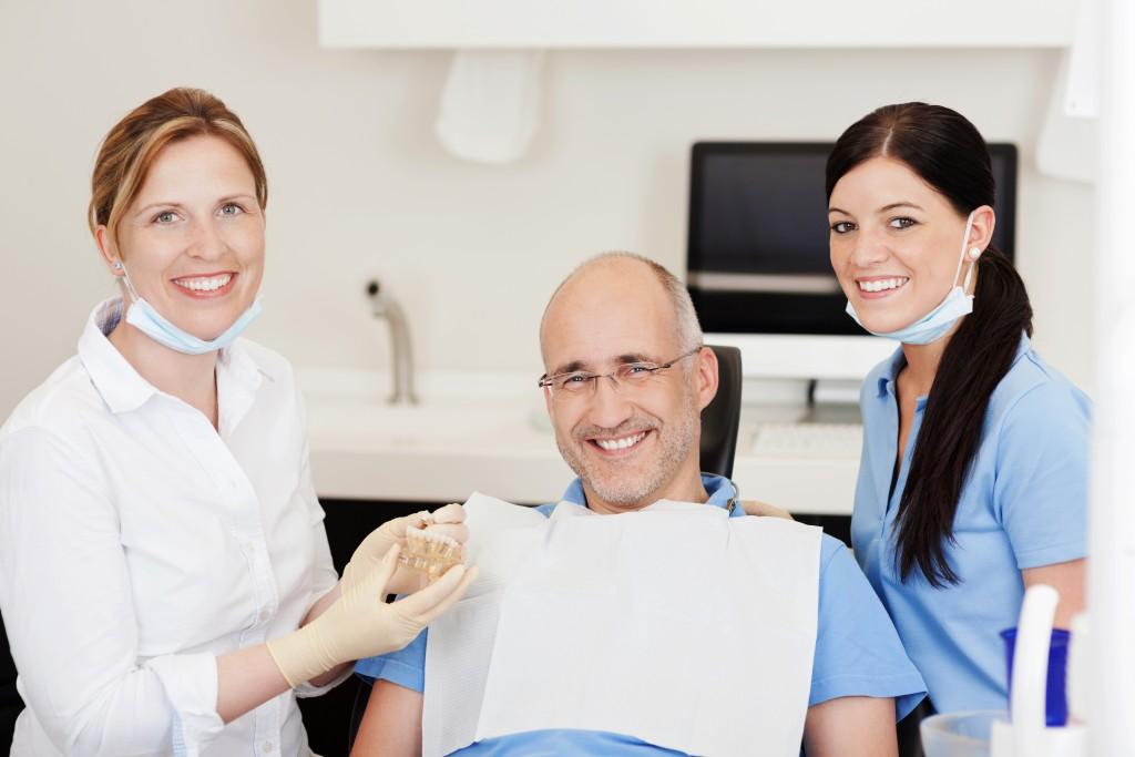 Dentist explaining dental implants to patient