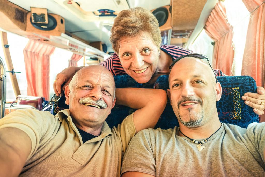 Adult man with elderly parents