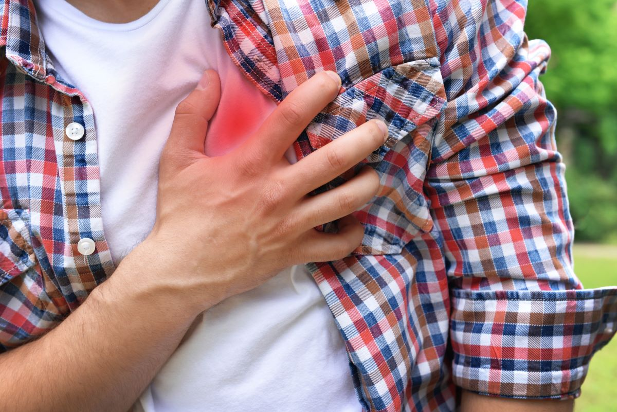 man holding chest heart attack
