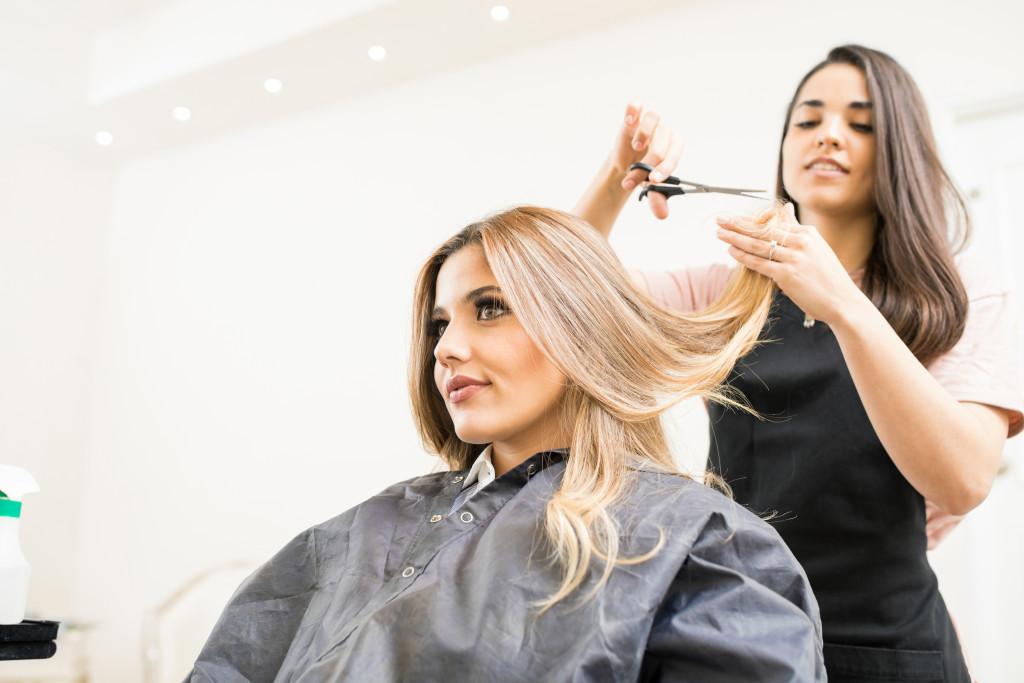 woman having a hair cut